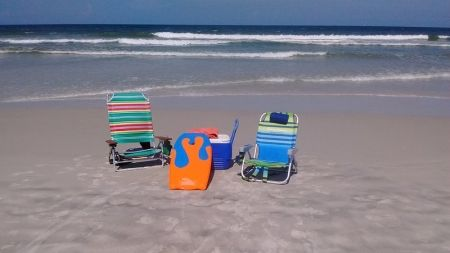 beach chairs, cooler and boogie board